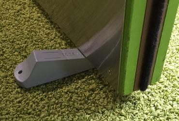 Door Handles with Integrated Doorstop